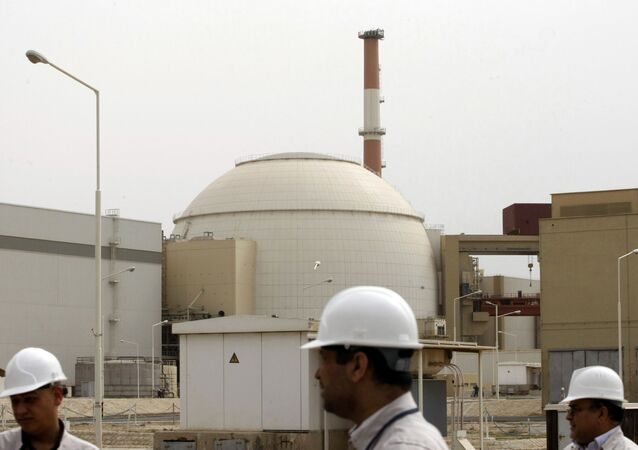 In this file photo taken on February 25, 2009, Iranian technicians walk outside the building housing the reactor of Bushehr nuclear power plant at the Iranian port town of Bushehr, 1200 Kms south of the capital Tehran.