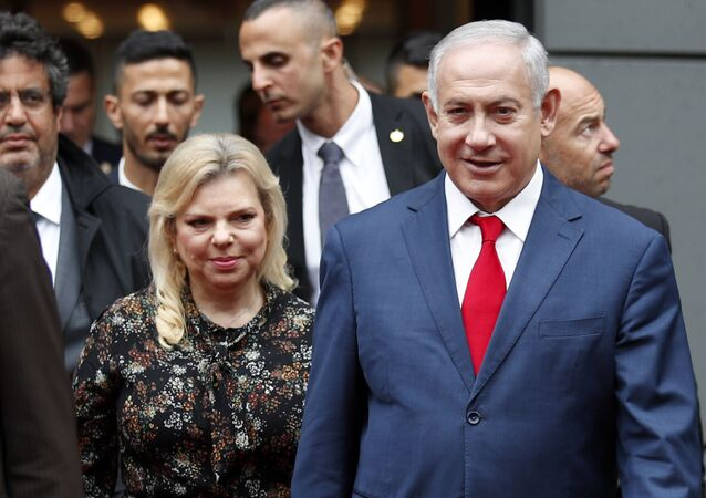 Israel's Prime Minister Benjamin Netanyahu and his wife Sara Netanyahu walk out after their meeting with French Finance Minister Bruno Le Maire, second left, at Bercy Economy Ministry, in Paris, Wednesday, June 6, 2018.