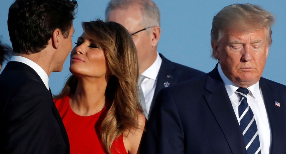 First Lady Melania Trump kisses Canada's Prime Minister Justin Trudeau next to the U.S. President Donald Trump during the family photo with invited guests at the G7 summit in Biarritz, France, August 25, 2019