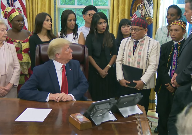 US President Donald Trump listens to the Rev. Dr. Hkalam Samson speak about Myanmar's ethnic and religious affairs at the White House on July 17, 2019. / White House video screenshot