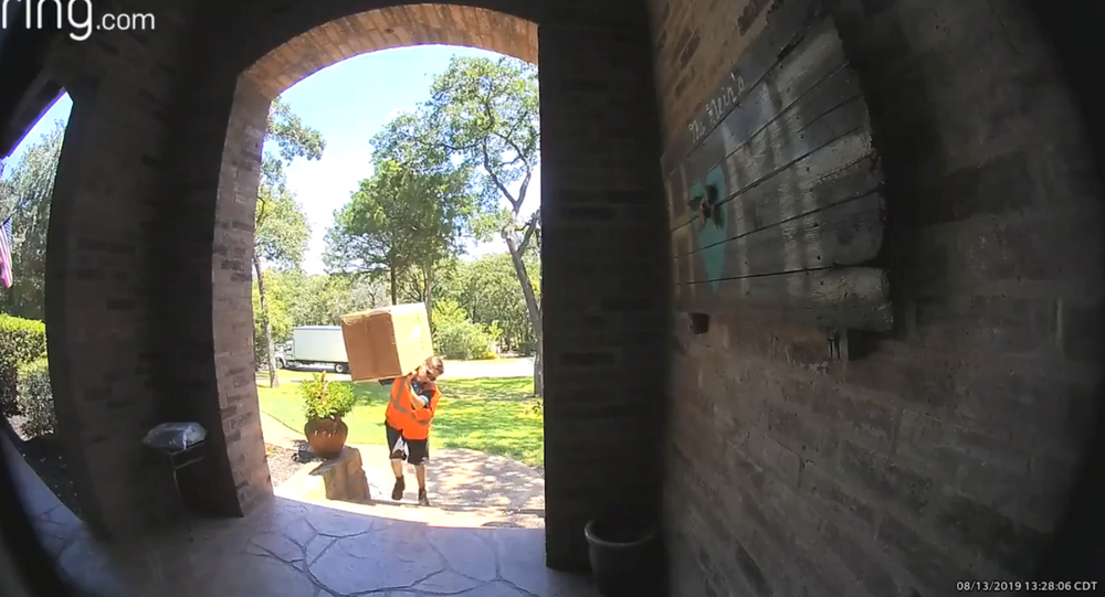 Delivery Man Gets Workout Carrying Heavy Package