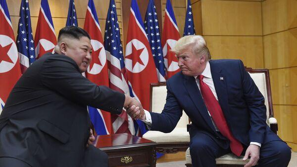 President Donald Trump meets with North Korean leader Kim Jong Un at the border village of Panmunjom in the Demilitarized Zone, South Korea, Sunday, June 30, 2019. - Sputnik International