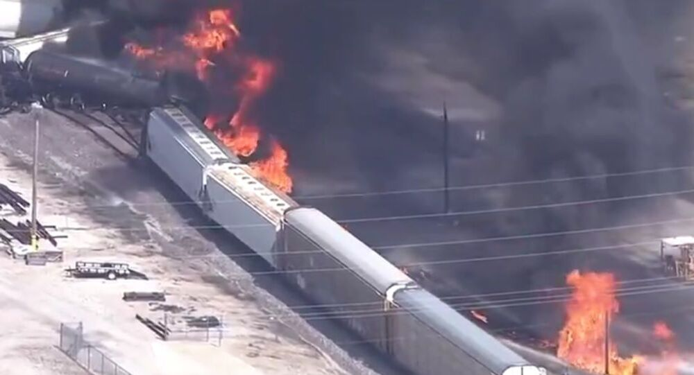 A cargo train has derailed near Dupo, Illinois resulting in a massive fire that sent a thick black plume of smoke into the sky