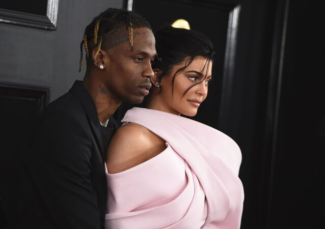 Travis Scott, left, and Kylie Jenner arrive at the 61st annual Grammy Awards at the Staples Center on Sunday, Feb. 10, 2019, in Los Angeles