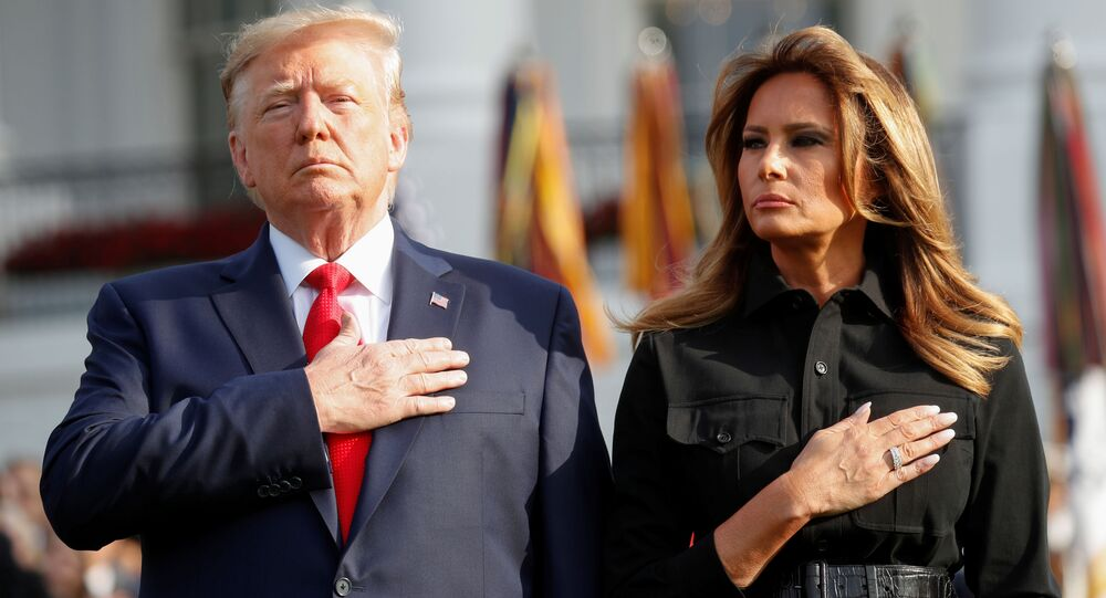 U.S. President Donald Trump and first lady Melania Trump observe a moment of silence to mark the 18th anniversary of September 11 attacks on the South Lawn of the White House in Washington, U.S., September 11, 2019