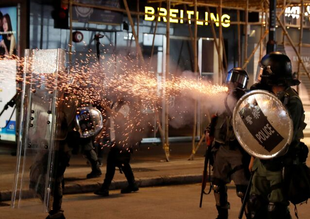 Riot police fire tear gas near Causeway Bay station in Hong Kong, China September 8, 2019