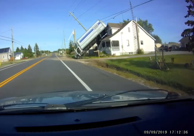 Commercial Truck Veers Into Ditch, Catapults Onto Nearby Home