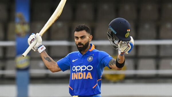 Virat Kohli of India celebrates his century during the 3rd ODI match between West Indies and India at Queens Park Oval, Port of Spain, Trinidad and Tobago, on August 14, 2019 - Sputnik International