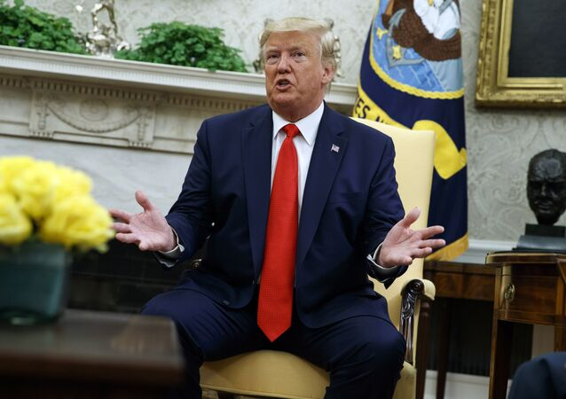 President Donald Trump talks about a plan to ban most flavored e-cigarettes, in the Oval Office of the White House, Wednesday, Sept. 11, 2019, in Washington