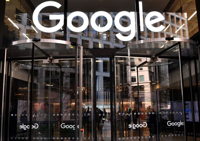 A logo is pictured above the entrance to the offices of Google in London on January 18, 2019