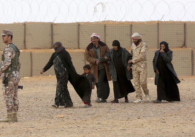 Syrian patients from the informal, Rukban camp are security cleared by the Tribes Army on the Syrian side