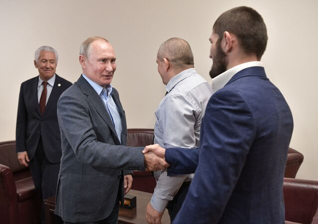 (File photo) Russian President Vladimir Putin and Ultimate Fighting Championship (UFC) lightweight titleholder Khabib Nurmagomedov shake hands during a meeting in Makhachkala, Russia. Head of Dagestan Republic Vladimir Vasilyev is at left. 12.09.2019