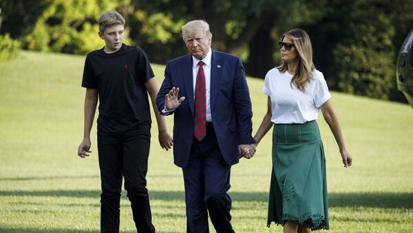 President Donald Trump, first lady Melania Trump and their son Barron Trump arrive at the White House in Washington, Sunday, Aug. 18, 2019, as they return from Bedminster, N.J.  - Sputnik International