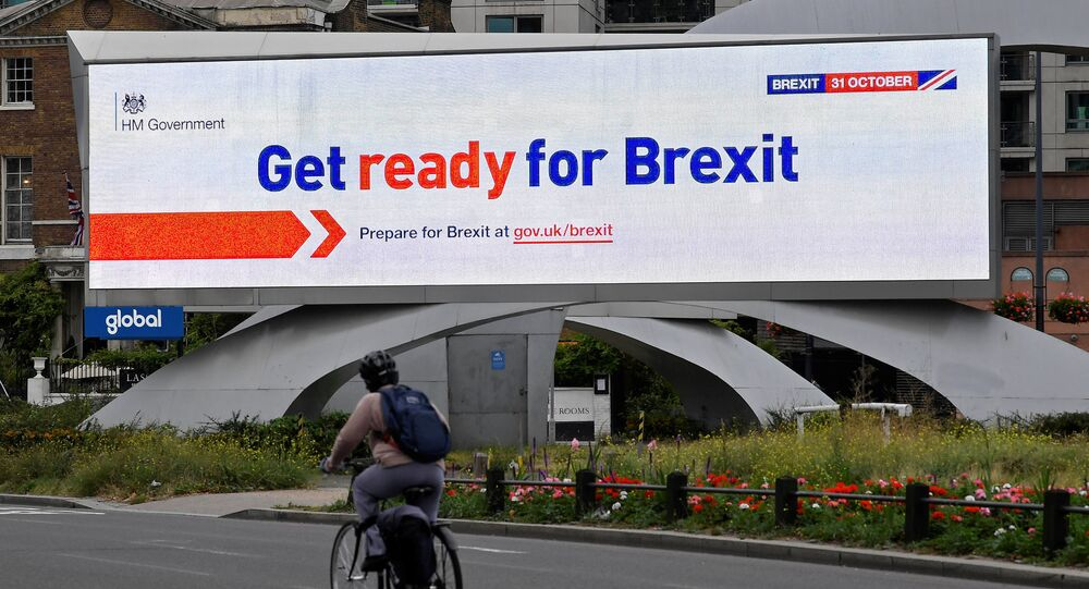 A cyclist rides past an electronic billboard displaying a British government Brexit information awareness campaign advertisement in London, Britain, September 11, 2019