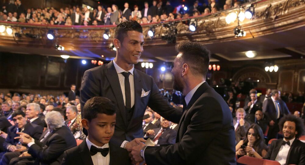 Portuguese soccer player Ronaldo, left, shakes hands with Argentine soccer player Lionel Messi during the The Best FIFA 2017 Awards at the Palladium Theatre in London, Monday, 23 October 2017.