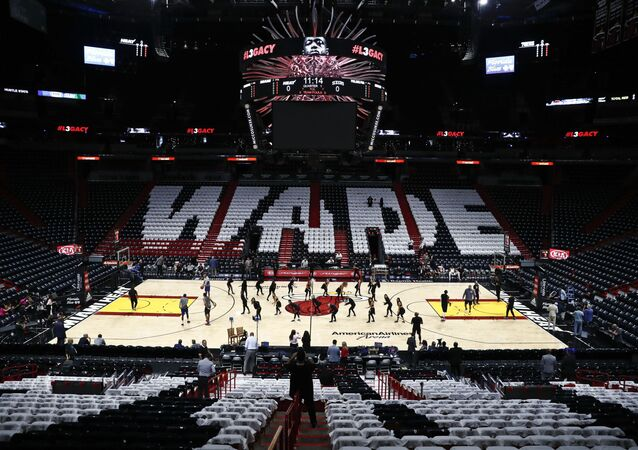 A general view shirts on the seats honoring Miami Heat's Dwyane Wade (3) prior to his final regular season home game of his career at American Airlines Arena prior to the game between the Philadelphia 76ers before an NBA basketball game Tuesday, April 9, 2019, in Miami. (AP Photo/Brynn Anderson)
