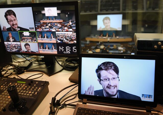Former US National Security Agency (NSA) contractor and whistle blower Edward Snowden is seen on screen in a control room as he speaks via video link from Russia as he takes part in a round table meeting on the subject of Improving the protection of whistleblowers on March 15, 2019, at the Council of Europe in Strasbourg, eastern France.