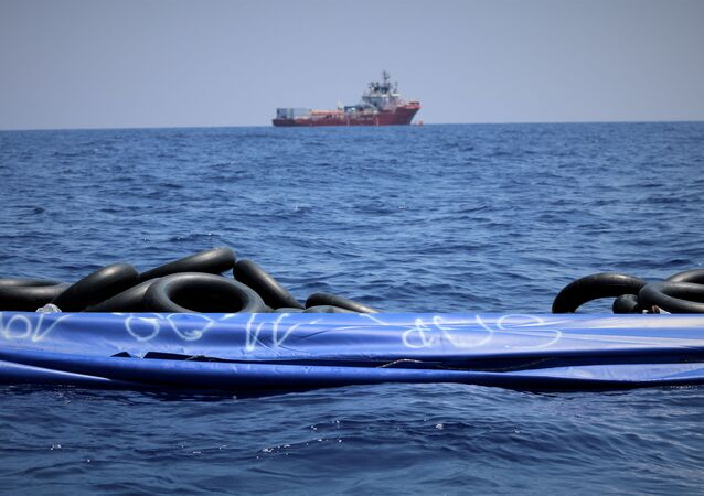 The migrant rescue ship Ocean Viking, run by French charities Medecins Sans Frontieres and SOS Mediterranee, floats in the distance, as it waits in international waters between Malta and the southern Italian island of Linosa for access to a port in this handout picture taken between August 9 and 12, 2019. Hannah Wallace Bowman/MSF/Handout via REUTERS   ATTENTION EDITORS - THIS IMAGE HAS BEEN SUPPLIED BY A THIRD PARTY. MANDATORY CREDIT.