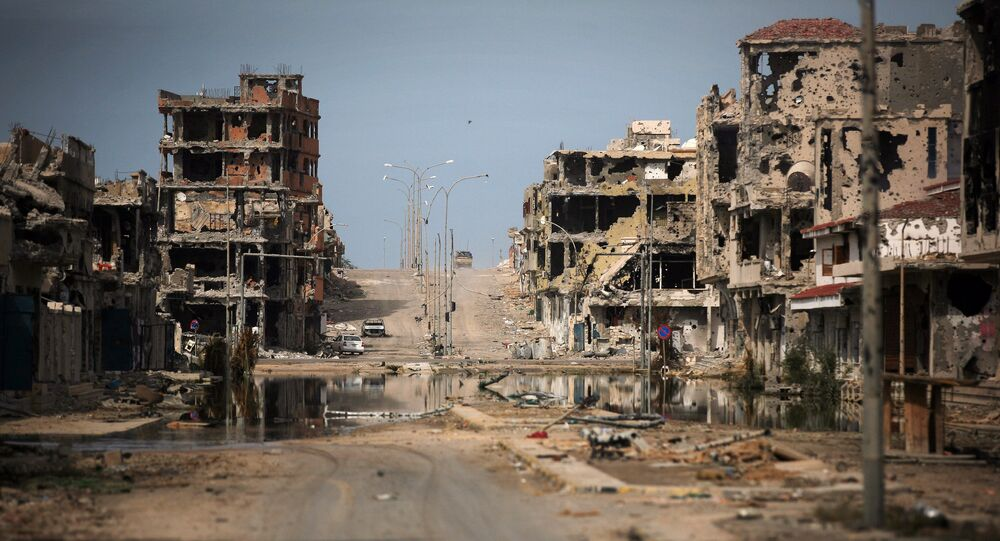 This Oct. 22, 2011 file photo, shows a general view of buildings ravaged by fighting in Sirte, Libya.