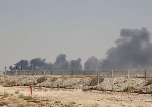 Smoke billows from an Aramco oil facility in Abqaiq about 60km (37 miles) southwest of Dhahran in Saudi Arabia's eastern province on September 14, 2019