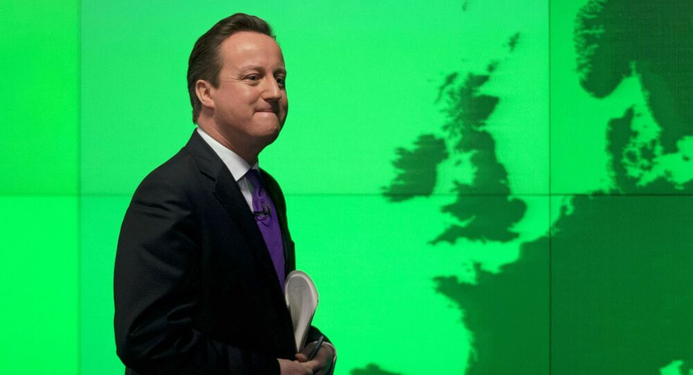 FILE - In this Wednesday, Jan. 23, 2013 file photo Britain's Prime Minister David Cameron walks past a map of Europe on a screen as he walks away after making a speech on holding a referendum on staying in the European Union in London.