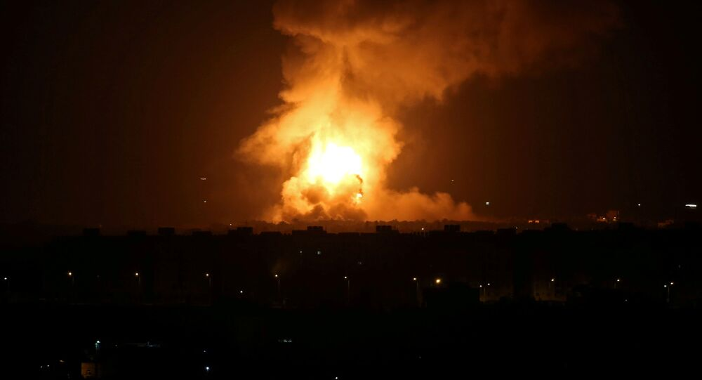 Flame and smoke are seen during an Israeli air strike in the central Gaza Strip September 11, 2019