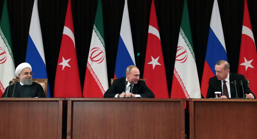 Iranian President Hassan Rouhani (L), Russian President Vladimir Putin (C) and Turkish President Recep Tayyip Erdogan (R) attending a press conference