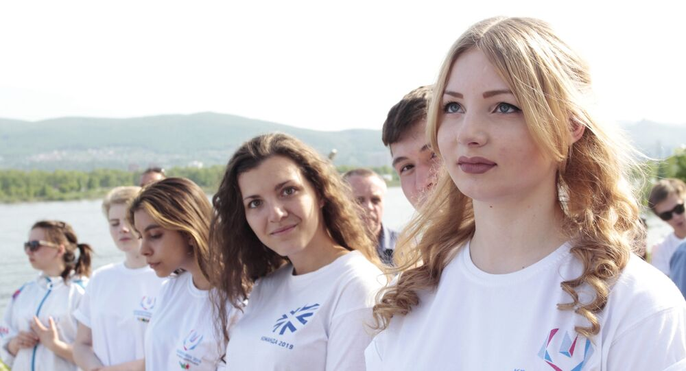Volunteers during a ceremony to mark the start of the countdown to the 2019 Winter Universiade in Krasnoyarsk.