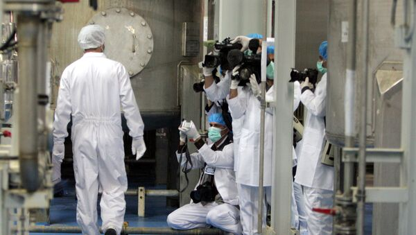 Cameramen and photographers take pictures as an Iranian technician walks through the Uranium Conversion Facility just outside the city of Isfahan 255 miles (410 kilometers) south of the capital Tehran, Iran, Saturday, Feb. 3, 2007 - Sputnik International