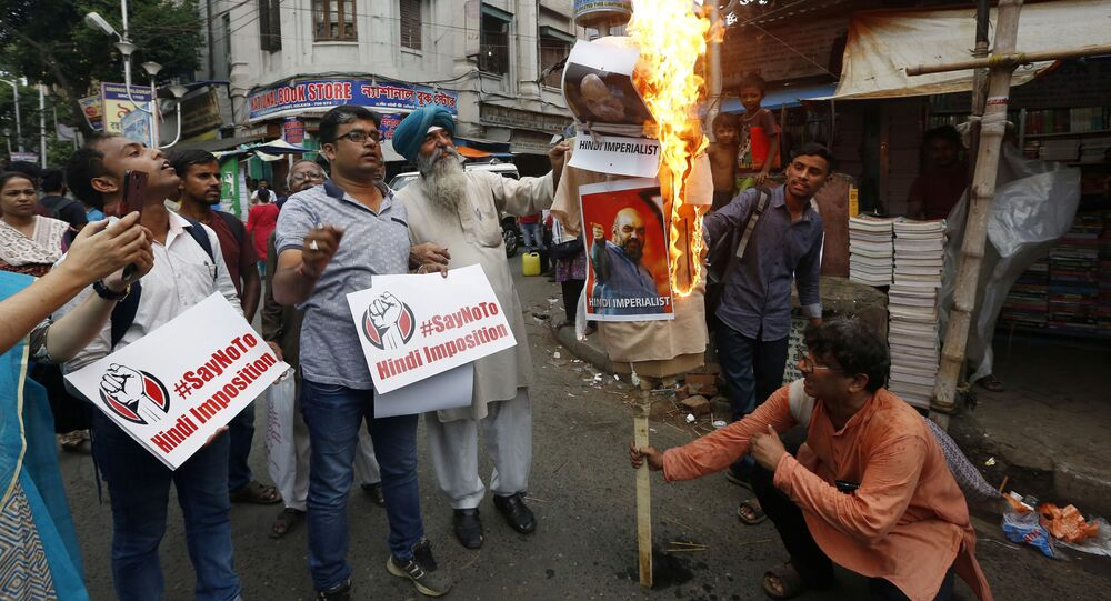 Protestors burn an effigy depicting India's Home Minister Amit Shah, during a protest against his proposal of 'One Nation, One Language' to promote Hindi, according to local media, in Kolkata, India September 16, 2019