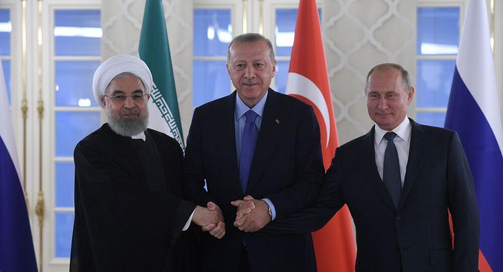 L-R: Iranian President Hassan Rouhani, Turkish President Recep Tayyip Erdogan and Russian President Vladimir Putin