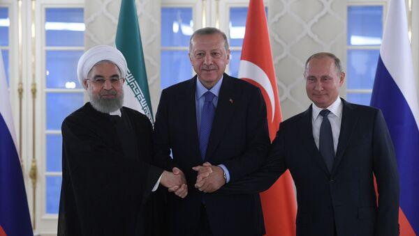 L-R: Iranian President Hassan Rouhani, Turkish President Recep Tayyip Erdogan and Russian President Vladimir Putin - Sputnik International