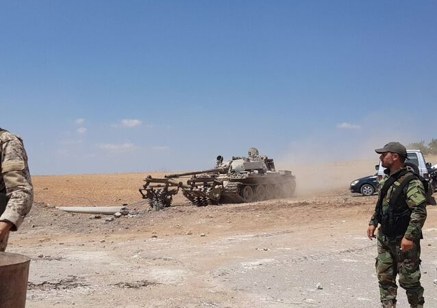The Syrian army conducts mine clearance outside the town of Khan Sheikhoun after its liberation, Idlib province, Syria