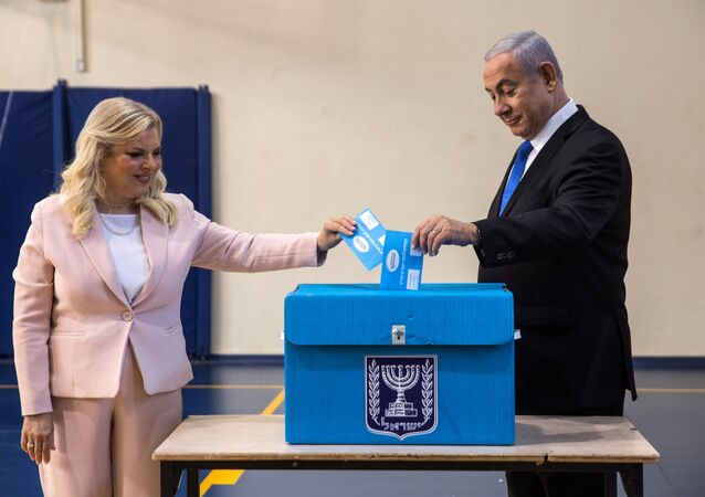 Israeli Prime Minister Benjamin Netanyahu and his wife Sara cast their vote during Israel's parliamentary election at a polling station in Jerusalem September 17, 2019