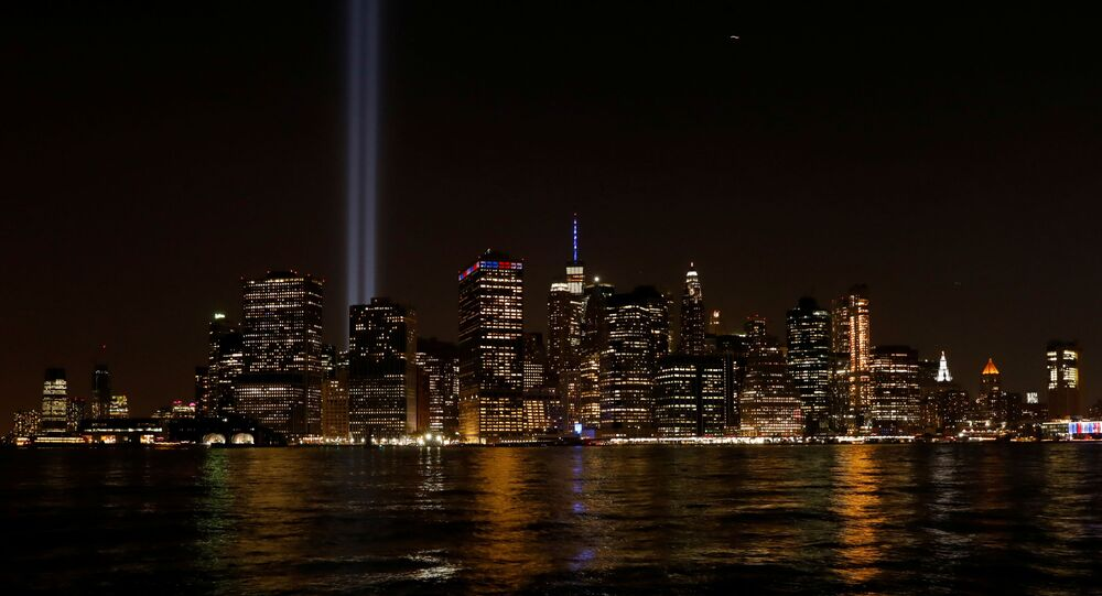 The Tribute in Light installation illuminates lower Manhattan, as seen from the borough of Brooklyn, marking the 18th anniversary of the 9/11 attacks in New York City, U.S., September 11, 2019