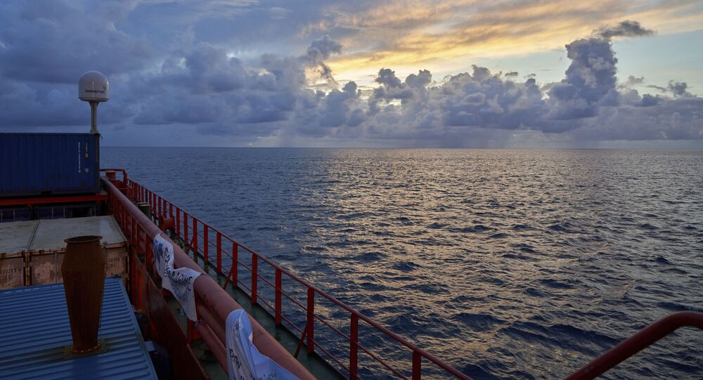 Sun rises near the tiny atoll of Alphonse where scientists began exploring the depths of the Indian Ocean, Thursday March 7, 2019