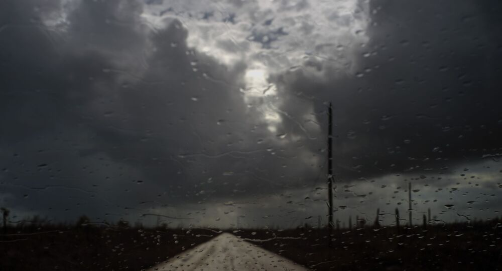 Rain drops cover a car's window shield prior to the arrival of a new tropical depression, that turned into Tropical Storm Humberto, in the aftermath of Hurricane Dorian en route to Mclean's Town, Grand Bahama, Bahamas, Friday Sept. 13, 2019.