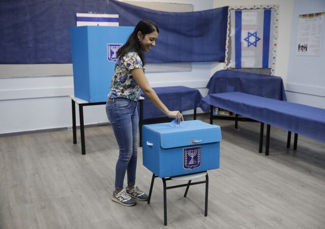 A woman votes a polling station in Rosh Haayin, Israel, Tuesday, Sept. 17, 2019.