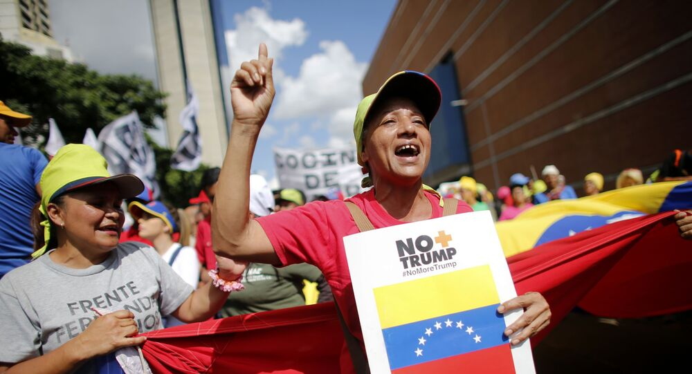 Supporters of President Nicolas Maduro chants slogans during a rally to celebrate the 11 years of the Socialist Party of Venezuela' youth, in Caracas, Venezuela, Thursday, Sept 12, 2019.