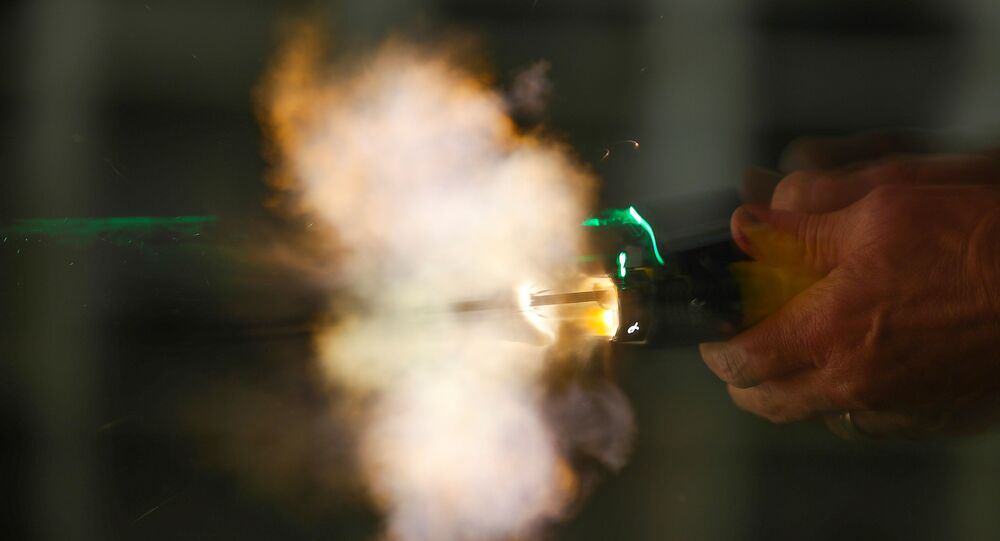 A new non-lethal weapon by BolaWrap, that discharges an 8 foot bola style Kevlar tether at 640 feet per second to entangle a subject at a range of 10-25 feet, is deployed during training in Laguna Niguel, California, U.S., September 5, 2019