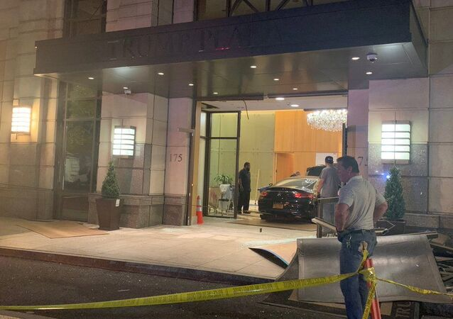 A black Mercedes-Benz smashed into the lobby of Trump Plaza in New Rochelle Tuesday night, injuring two people and the driver, police said.