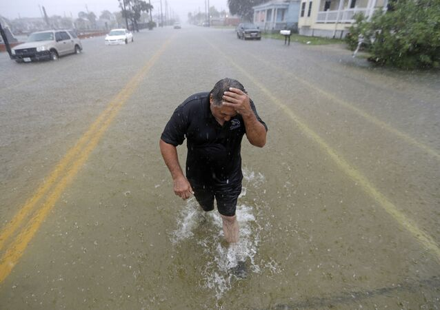 Angel Marshman wades through floodwaters from Tropical Depression Imelda after trying to start his flooded car Wednesday, Sept. 18, 2019, in Galveston, Texas. (AP Photo/David J. Phillip)