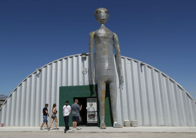 People enter and exit the Alien Research Center in Hiko, Nev. No one knows what to expect, but lots of people are preparing for Storm Area 51 on Wednesday, Sept. 18, 2019, in the Nevada desert