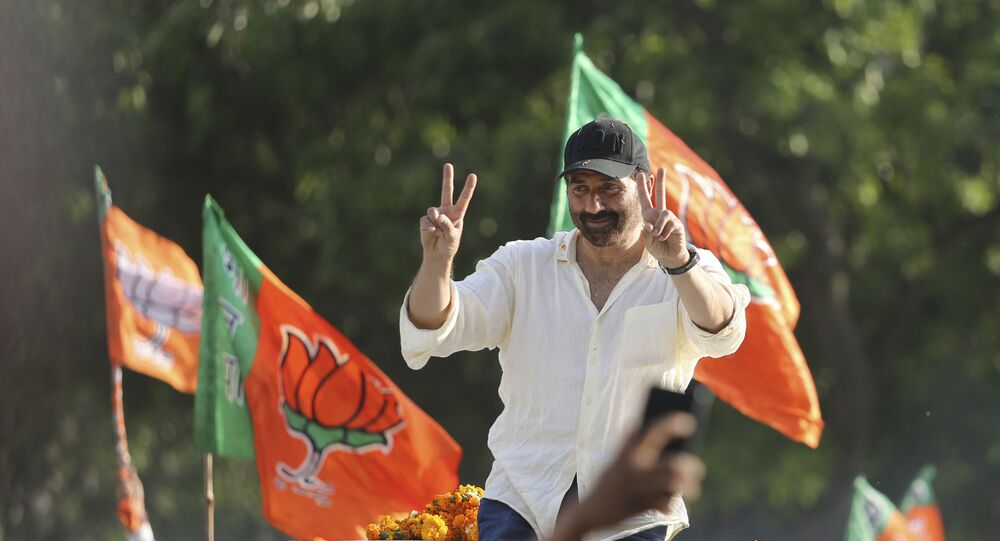 Bollywood actor and India's ruling Bharatiya Janata Party (BJP) candidate Sunny Deol gestures to the crowd during an election campaign road show at Dinanagar in northern state of Punjab, India, Thursday, May 2, 2019
