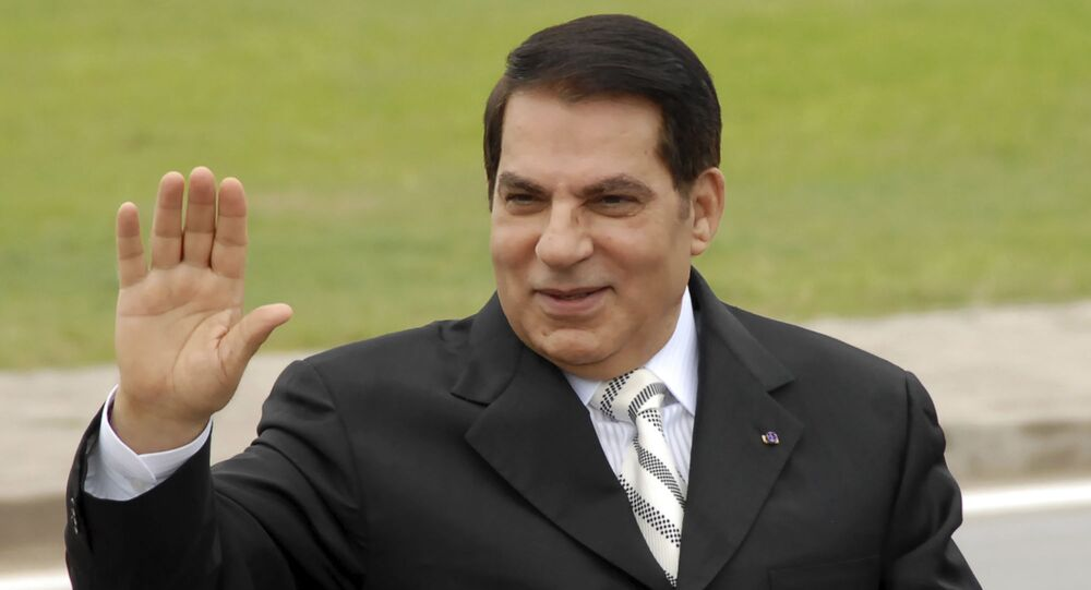 FILE - In this Oct.11, 2009 file photo, then Tunisian President Zine El Abidine Ben Ali waves from his car as he arrives at campaign rally in Rades, outside Tunis. A lawyer for the former Tunisian president ousted in the 2011 Arab Spring says Zine El Abidine Ben Ali has been hospitalized in Saudi Arabia