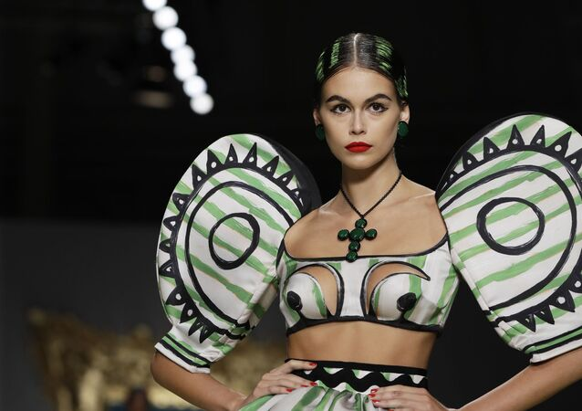Model Kaia Gerber wears a creation showing off the Moschino Spring-Summer 2020 collection, unveiled during fashion week in Milan, Italy on 19 September 2019.