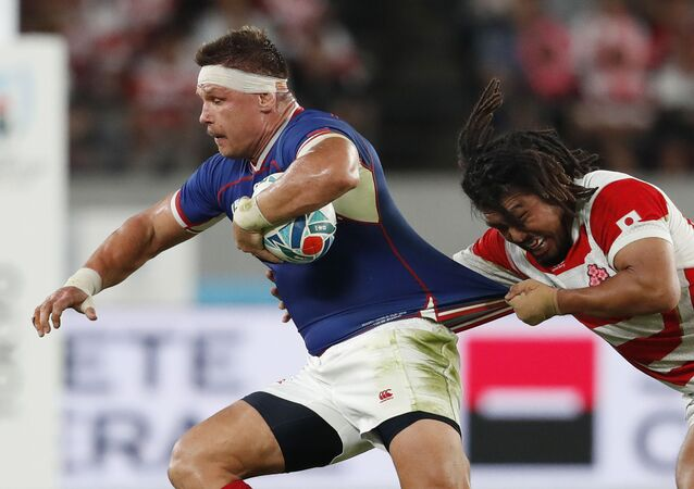 Rugby Union - Rugby World Cup 2019 - Pool A - Japan v Russia - Tokyo Stadium, Tokyo, Japan - September 20, 2019 Russia's Vitaly Zhivatov in action with Japan's Shota Horie