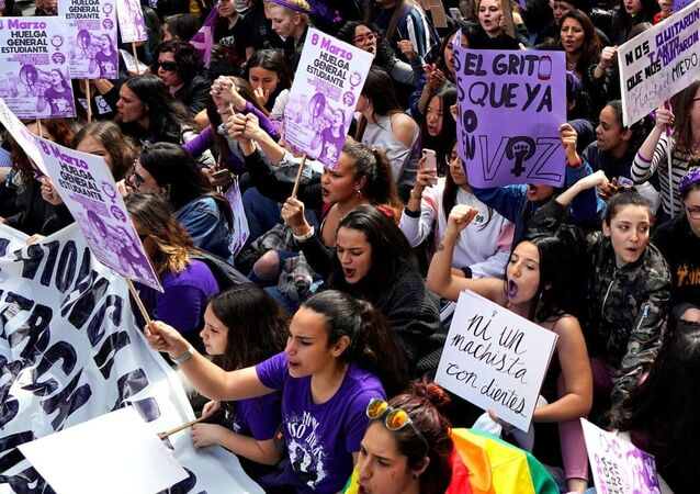 Protesters in Madrid on International Women's Day. Organisers are aiming to 'turn the night purple', the colour of the feminist movemen