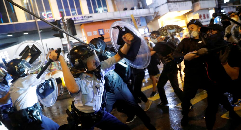 Police clash with anti-extradition bill protesters after a protest, at Tsuen Wan, in Hong Kong