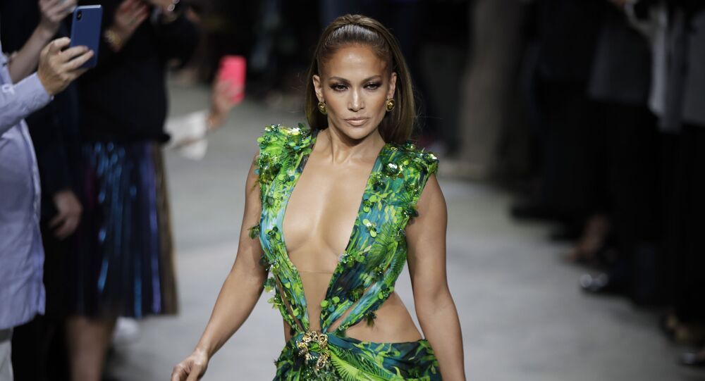Actress Jennifer Lopez wears a creation as part of the Versace Spring-Summer 2020 collection, unveiled during the fashion week, in Milan, Italy, Friday, Sept. 20, 2019
